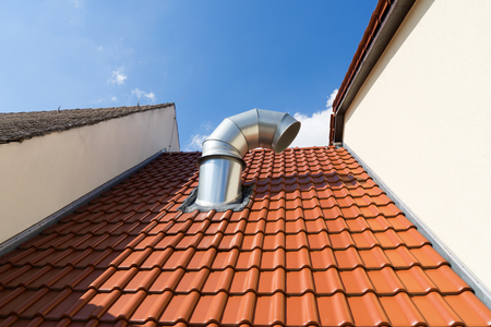 vent: House roof with large vent pipe