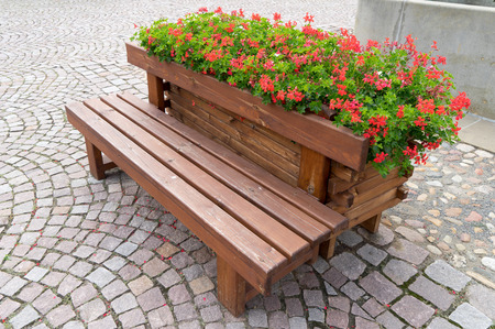 wooden bench: Wooden bench with flower pots and flowers Stock Photo