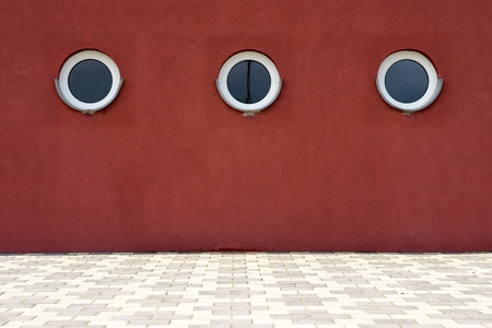 round window: round window in a red house Stock Photo