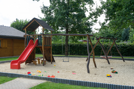 recreational climbing: Playground with swing and slide for children