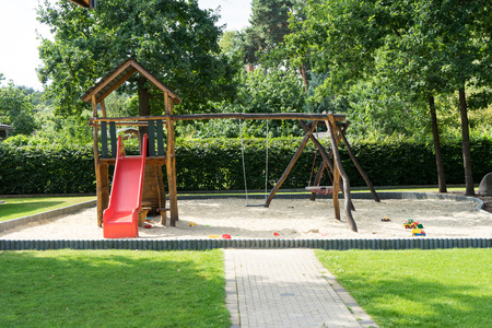 romp: Playground with swing and slide for children
