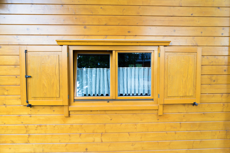 shutters: Log house with window and window shutters Stock Photo