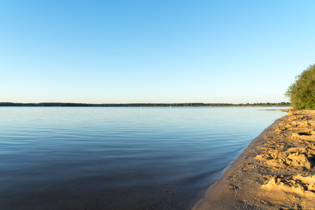 is cloudless: Lake and a cloudless blue sky