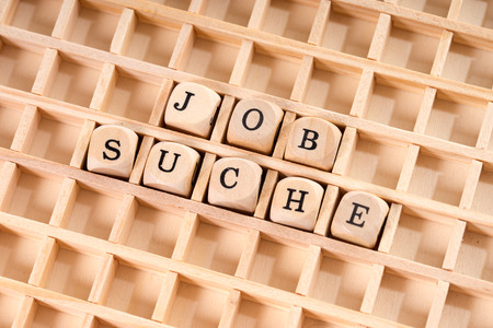 place of employment: Wooden cube with the German words job search