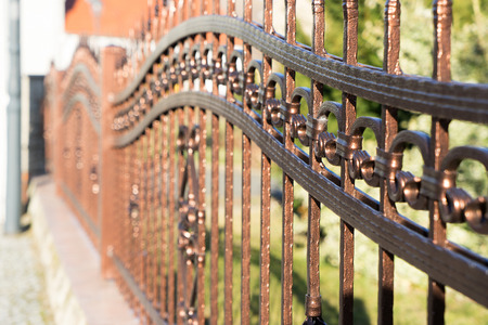 and plot: fence made of metal on a plot