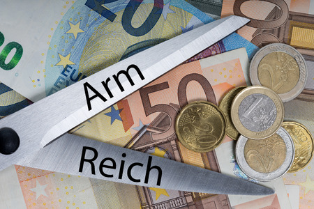 wage earners: euro money and scissors with the words arm and empire