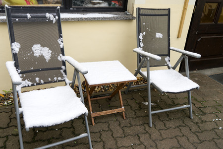 garden furniture: Garden furniture covered with snow Stock Photo