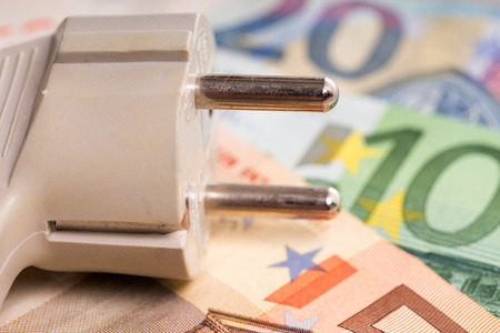 electricity plug and euro banknotes Stock Photo