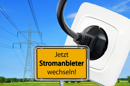 electricity tariff: Street sign with the german words switch electricity providers now