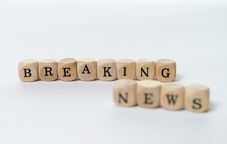 wooden cubes with the words breaking news