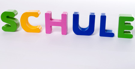 Colorful wooden letters with the german word school