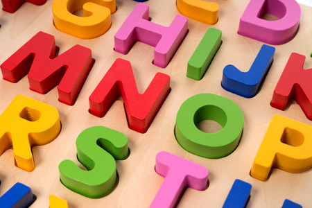 Colorful letters on a wooden board