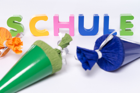 Sugar cones and colorful letters with the german word school