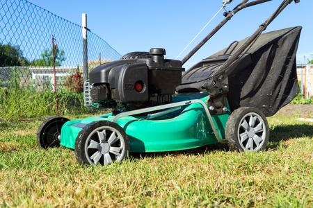 Lawn mower on a meadow in a garden