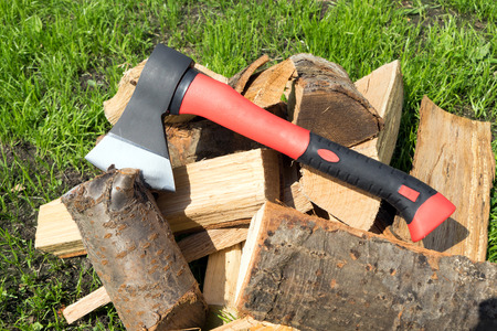 Ax and chopped firewood Stock Photo