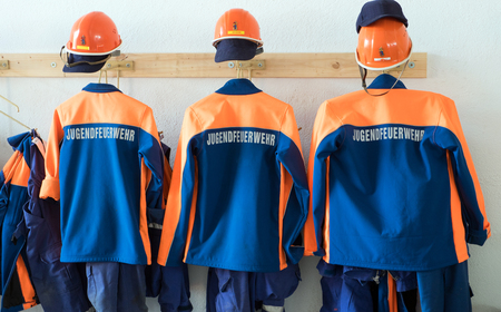 fire brigade uniform in a equipment house 版權商用圖片 - 84735350