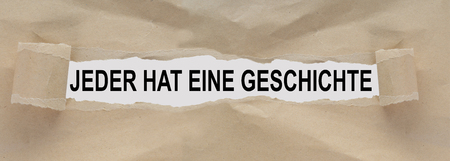 Text box with the german words Everyone has a story 写真素材