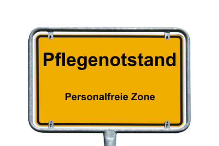 town sign with the german words nursing shortage and personnel-free zone Standard-Bild - 97223997