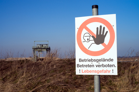 sign with the german words company premises Entering prohibited Danger to life