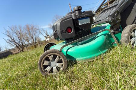 Lawn mower on the meadow in a garden Stock fotó