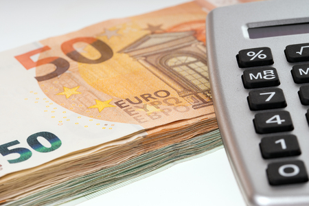 many euro banknotes and calculator