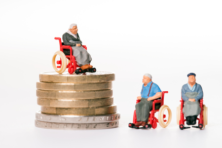 old people in wheelchairs and coins Standard-Bild - 116212955