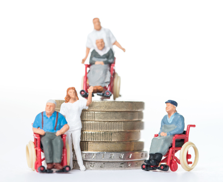 Nursing staff with old people and coin money