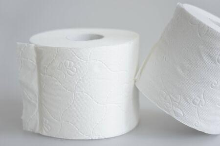 white toilet paper on gray background