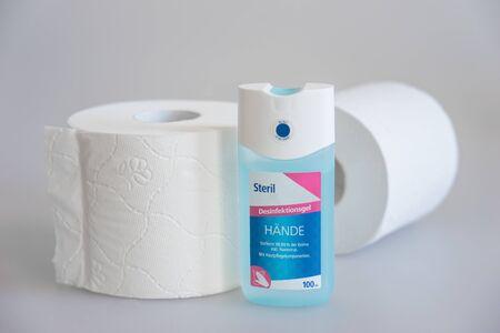 white toilet paper and hand sanitizer Standard-Bild