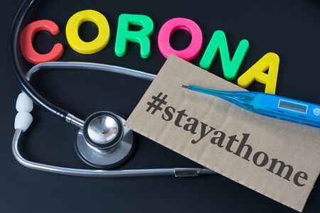 Blackboard with the word Corona and stay at home Standard-Bild
