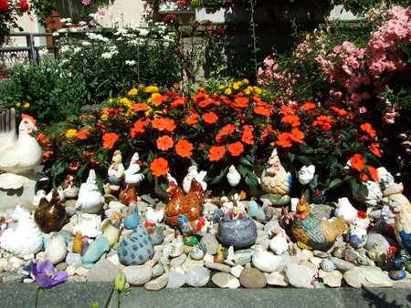 Garden dwarfs in flowers, Arbon