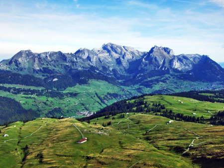 Autumn pastures and hills on the plateau beneath the mountain ranges Churfirsten - Canton of St. Gallen, Switzerland Stock Photo