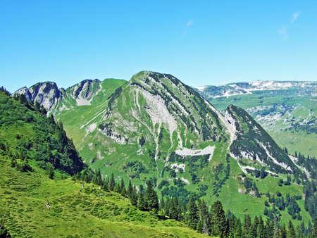 Alpine peak Förenchopf above the Voralpsee lake and the Alviergruppe mountain range - Canton of St. Gallen, Switzerland Stock Photo