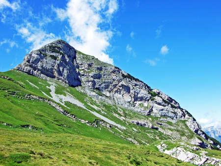 Alpine peak Margelchopf above the Voralpsee lake and the Alviergruppe mountain range - Canton of St. Gallen, Switzerland