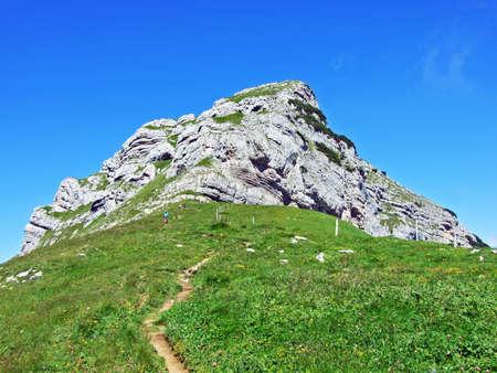 Alpine peak Margelchopf above the Voralpsee lake and the Alviergruppe mountain range - Canton of St. Gallen, Switzerland Stock Photo