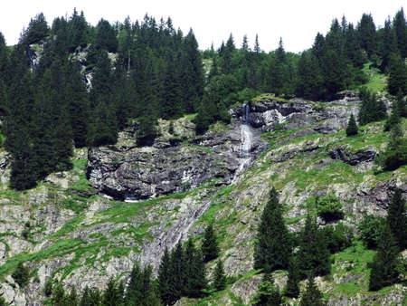 Seasonal waterfalls and cascades in the alpine valley of Maderanertal - Canton of Uri, Switzerland