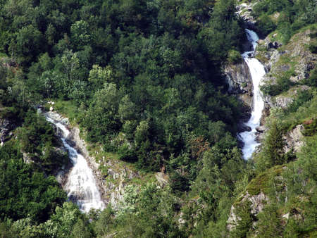 Seasonal waterfalls and cascades in the alpine valley of Maderanertal - Canton of Uri, Switzerland