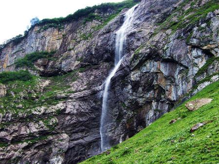 Waterfall Wannenbachfall in the alpine valley of Im Loch - Canton of Glarus, Switzerland