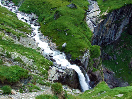 Waterfall Unterer Jetzbachfall in the alpine valley of Im Loch - Canton of Glarus, Switzerland