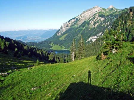 Alpine peak Margelchopf above the Voralpsee lake and in the Alviergruppe mountain range - Canton of St. Gallen, Switzerland Stock Photo