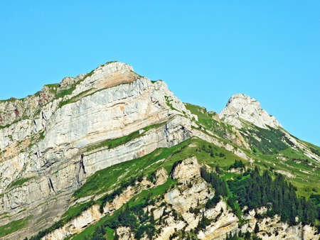 Alpine peak Margelchopf above the Voralpsee lake and in the Alviergruppe mountain range - Canton of St. Gallen, Switzerland