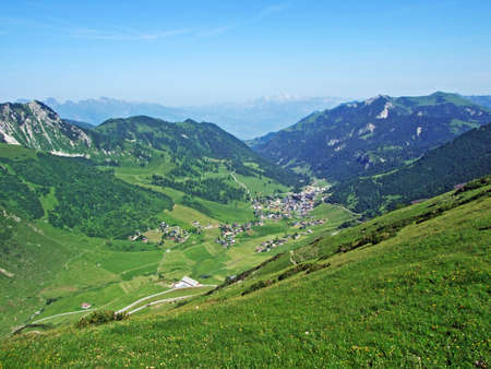 View of the Malbuntal alpine valley and ski-resort village Malbun from the slopes of the Liechtenstein Alps mountain range - Malbun, Liechtenstein