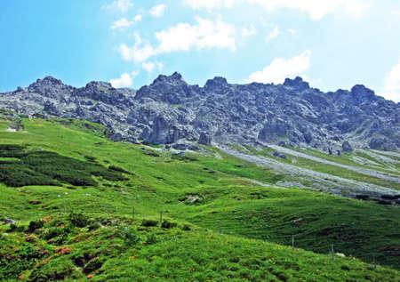 Rocks and stones of the Liechtenstein Alps mountain range and over the Malbuntal alpine valley - Malbun, Liechtenstein