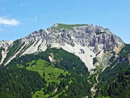 Alpine mountain peak Ochsenkopf over the Malbuntal alpine valley and in the Liechtenstein Alps mountain range - Malbun, Liechtenstein