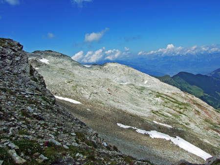 Rocks and stones of the Liechtenstein Alps mountain massiv and over the Naaftal alpine valley - Malbun, Liechtenstein