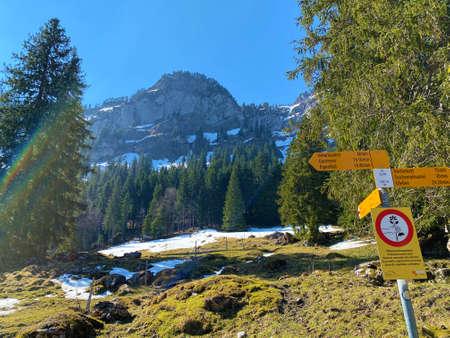 Mountaineering signposts and markings on the hills over the Eigental alpine valley and in central Switzerland, Eigenthal - Canton of Lucerne, Switzerland (Kanton Luzern, Schweiz)