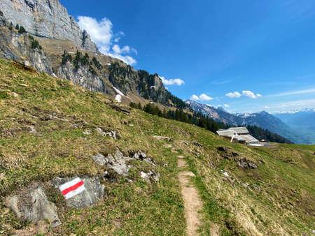 Mountaineering signposts and markings on the slopes of the Churfirsten mountain range and over lake Walensee, Walenstadtberg - Canton of St. Gallen, Switzerland (Kanton St. Gallen, Schweiz)