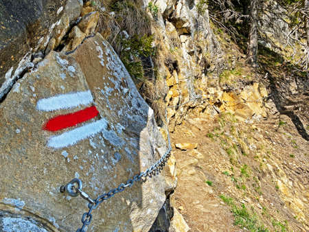 Mountaineering signposts and markings on peaks and slopes of the Pilatus mountain range and in the Emmental Alps, Alpnach - Canton of Obwalden, Switzerland (Kanton Obwald, Schweiz) 스톡 콘텐츠