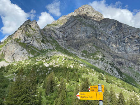 Mountaineering signposts and markings on the slopes of the Melchtal alpine valley and in the Uri Alps mountain massif, Kerns - Canton of Obwalden, Switzerland (Kanton Obwald, Schweiz)