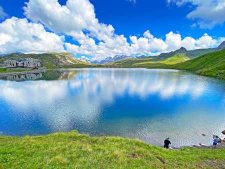 Fishermens on the artificial alpine lake Melchsee or Melch lake in the Uri Alps mountain massif, Melchtal - Canton of Obwalden, Switzerland (Kanton Obwald, Schweiz)